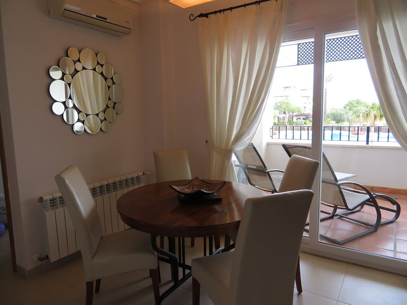 Lovely Dining Setting with outlook towards the pool and town centre
