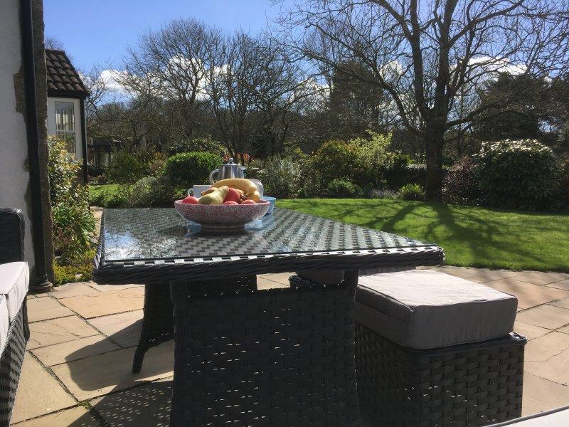 Le jardin à l'usage exclusif des clients dans le Cottage.