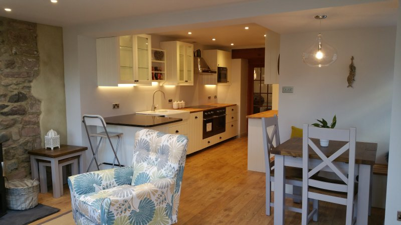 New Kitchen with dining area and breakfast bar and open plan garden room