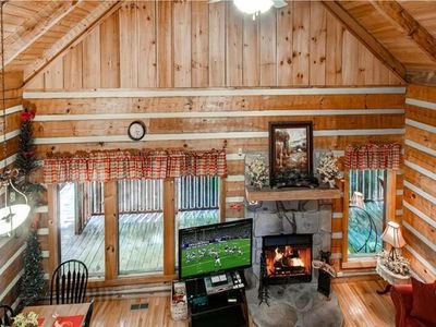 Cathedral ceiling, wood burning fireplace, 55' high definition tv, and wifi.