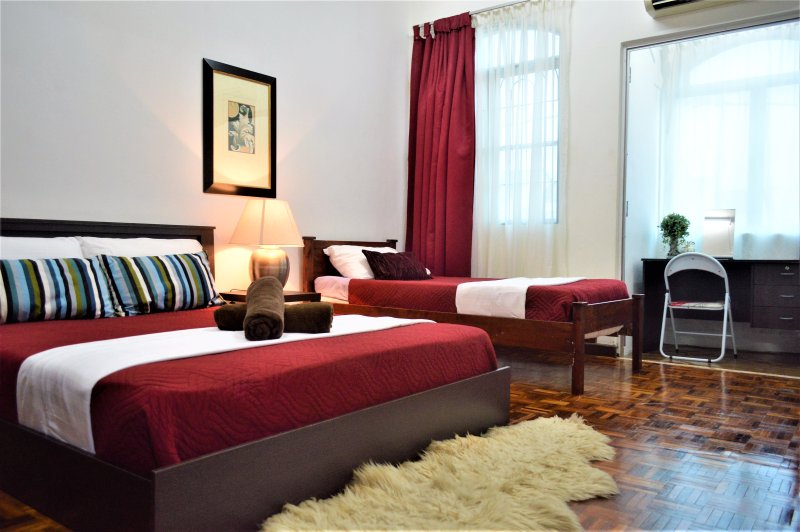 Master bedroom- (1st floor with AC) with a Queen bed & Single bed. Sleep 4 pax with extra mattress.