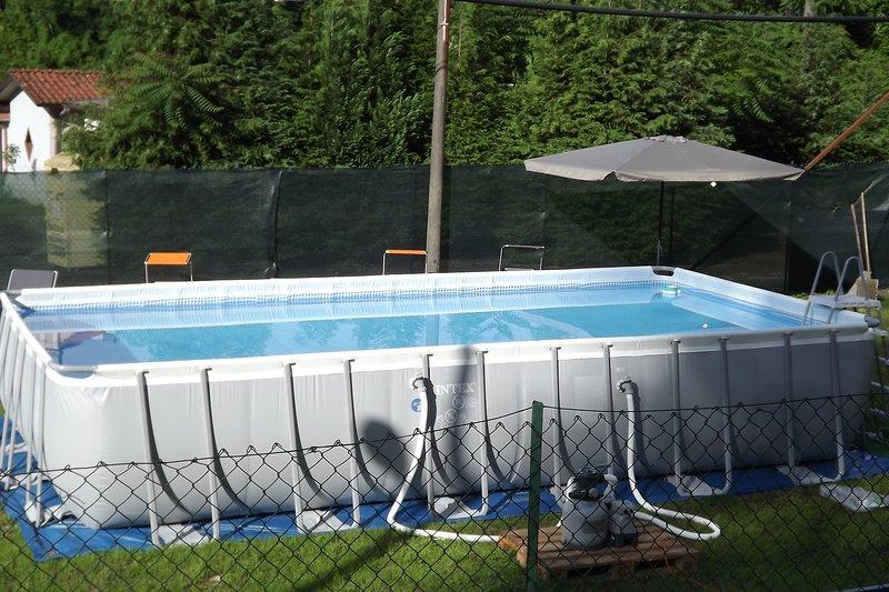 Private equipped seasonal outdoor pool with sun umbrellas gazebo