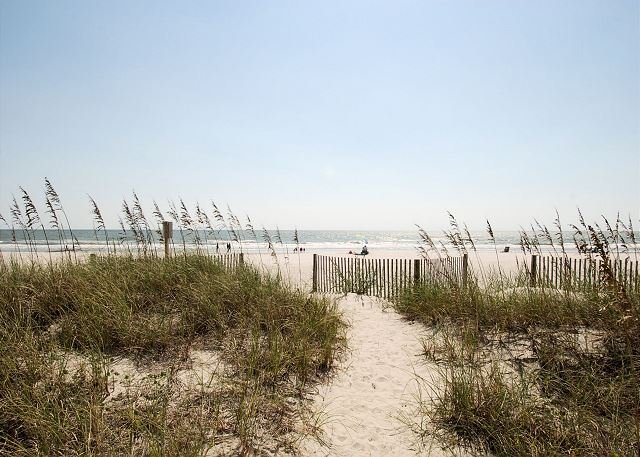 Walk right out to the beach from this condo.