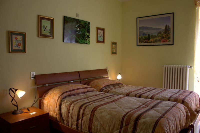 Room with two single beds and outside bathroom. Room with 2 single beds and shared bathroom.