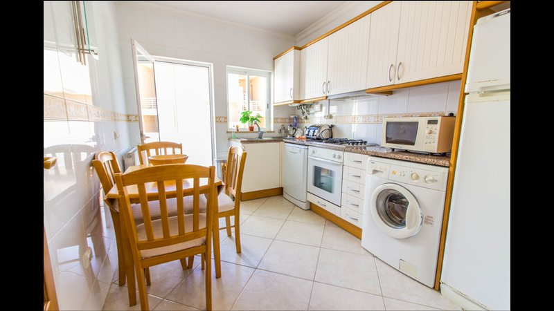 Fully equipped kitchen with its own balcony great for eating alfresco