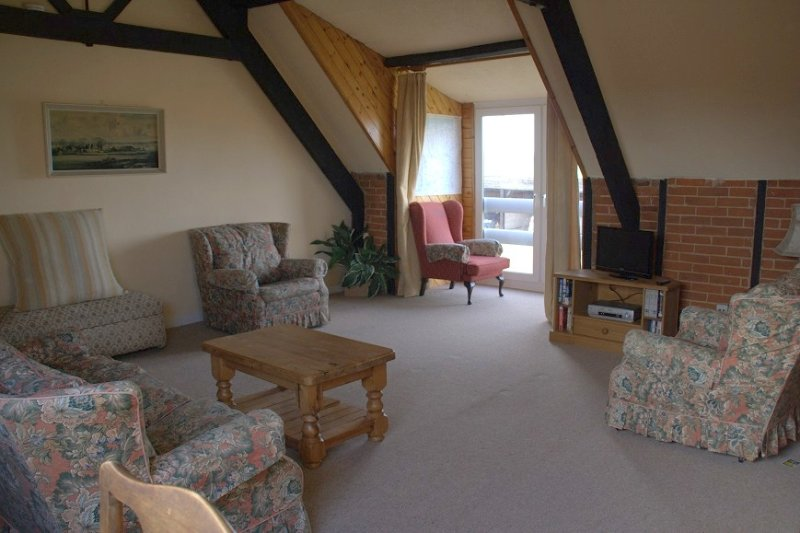 Relax in the spacious living room upstairs room