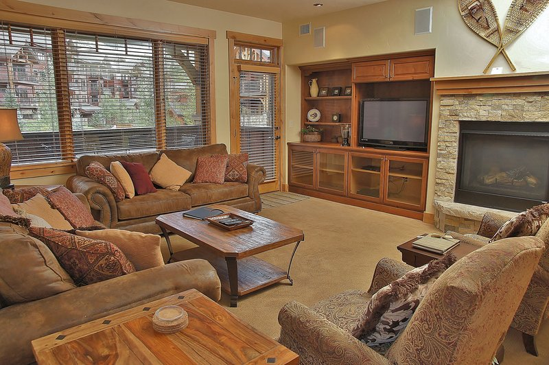 Living Room - with Gas Fireplace, HDTV, DVD, & Surround Sound stereo