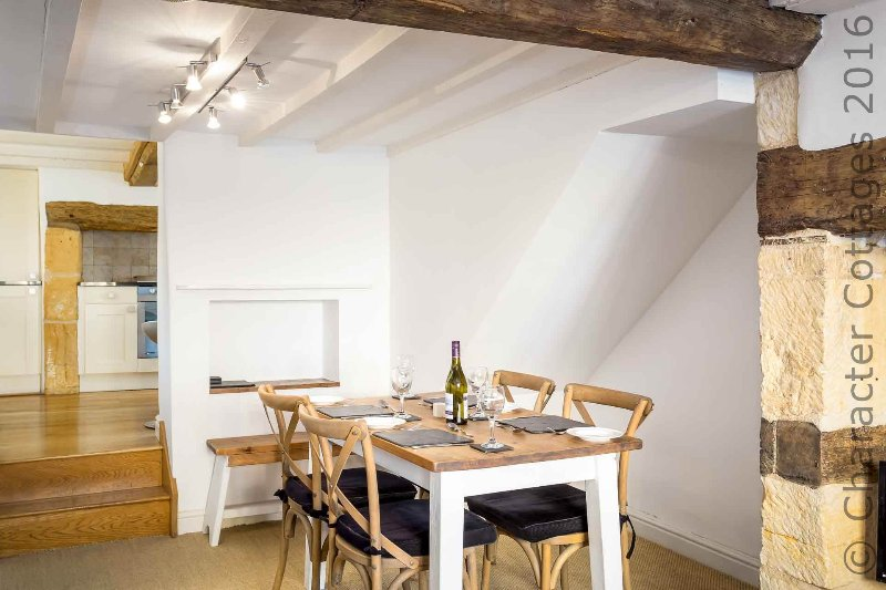 The dining table can seat up to six (set for four here)