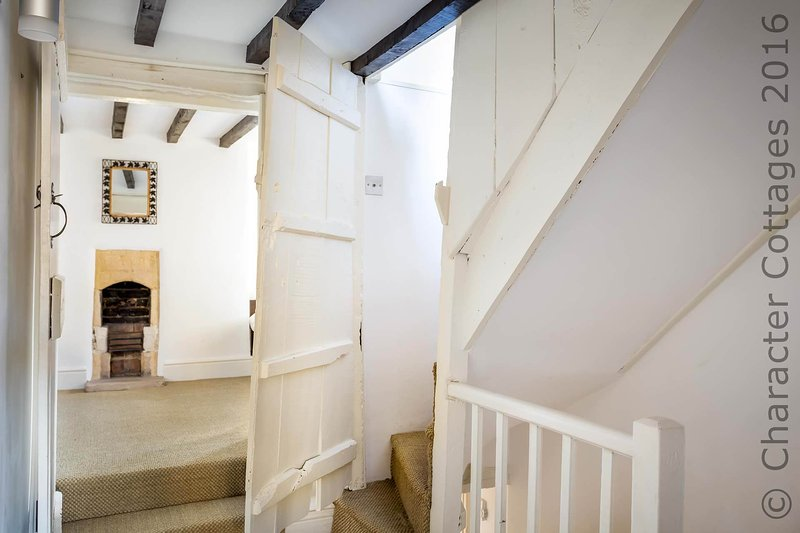 Steep, winding stairs lead up to bedroom 3