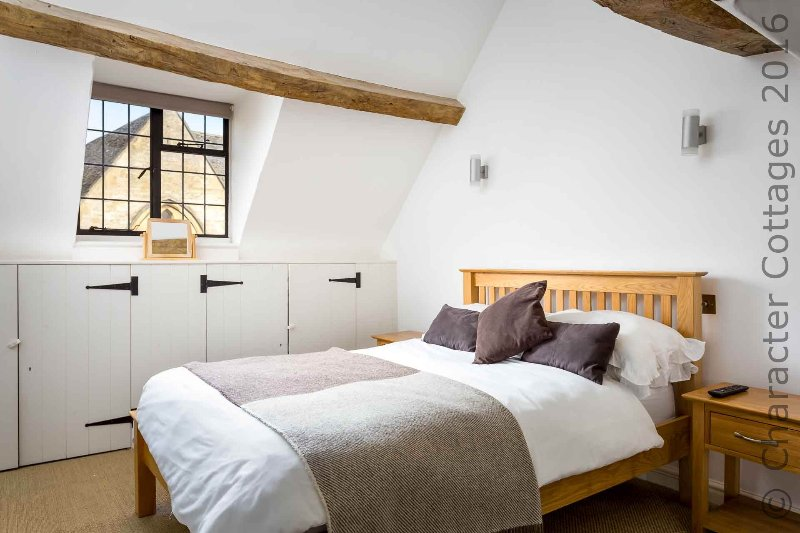 Bedroom 3 is in the eaves, with a double bed