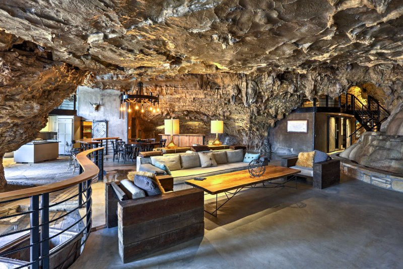 Admire cavern walls and stalactites hanging from the ceiling!