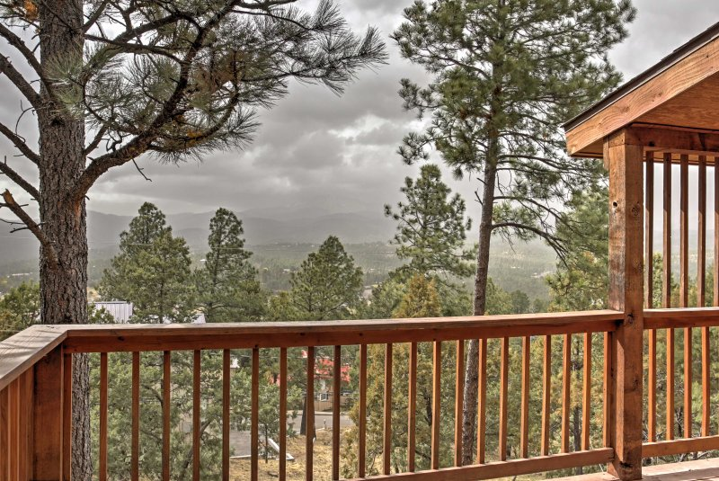 Enjoy tall pine views when you stay at this 4-bedroom, 3-bathroom vacation rental cabin in Ruidoso.