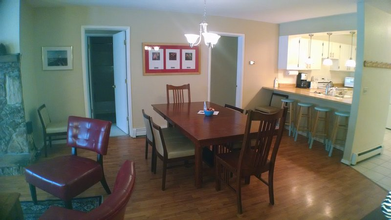 View of dining room and kitchen breakfast bar with seating for four.
