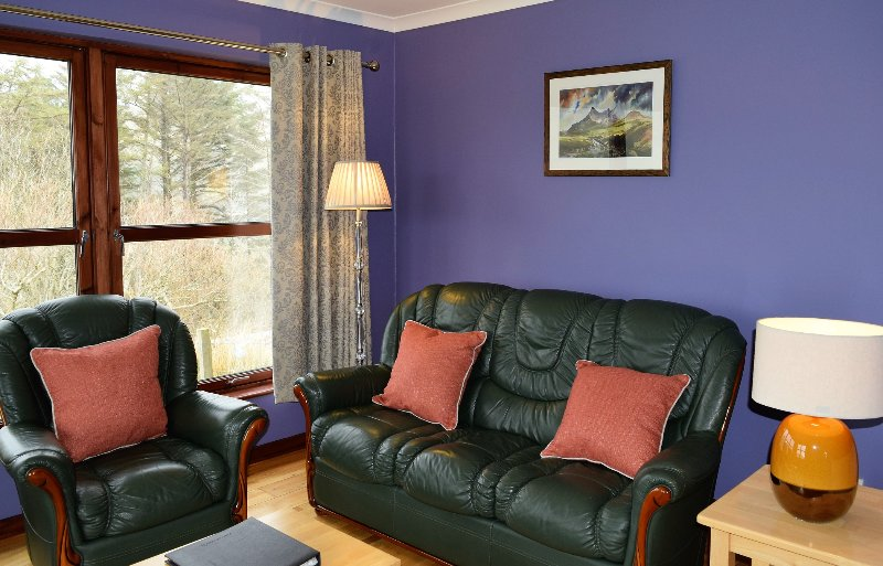 Newly painted & curtained sitting area waiting for new suite.