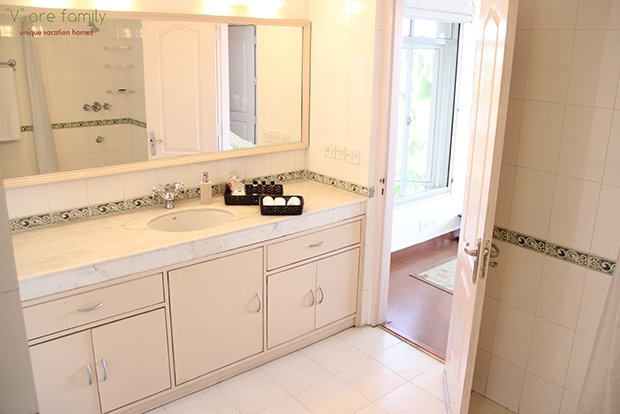Bathroom attached to the third bedroom done in white with free amenities