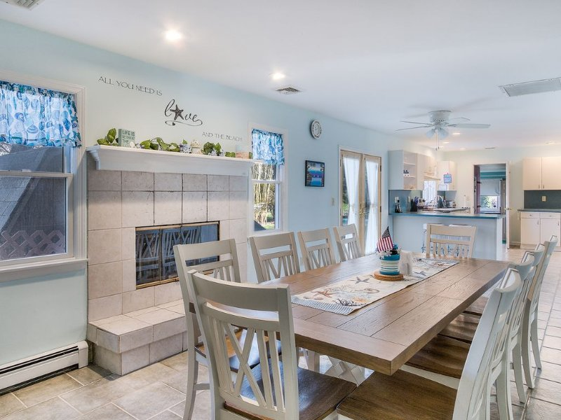 Dining area and kitchen with open fire place