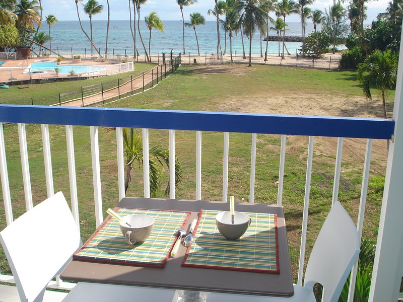 balcony overlooking the beach of the residence