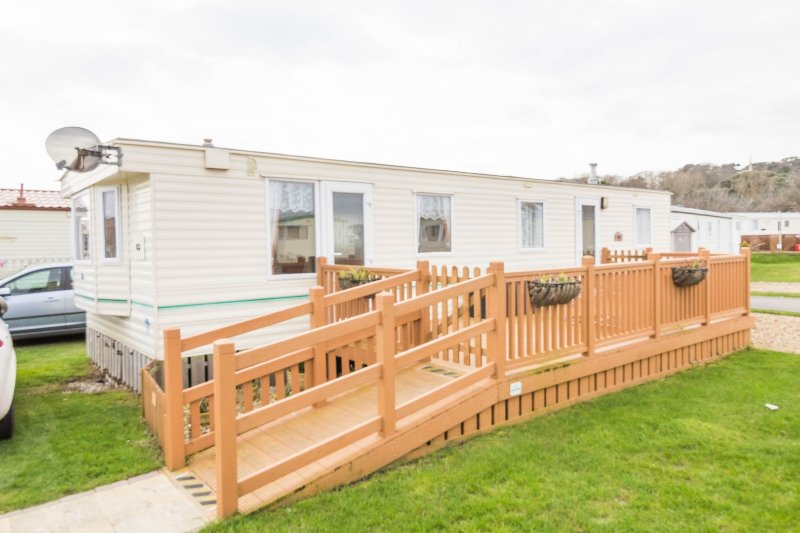 8 berth caravan with decking for hire at North Denes Holiday Park.
