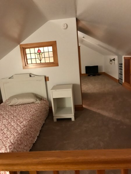 Open area upstairs with 2 twin beds split apart by 1/2 bath.