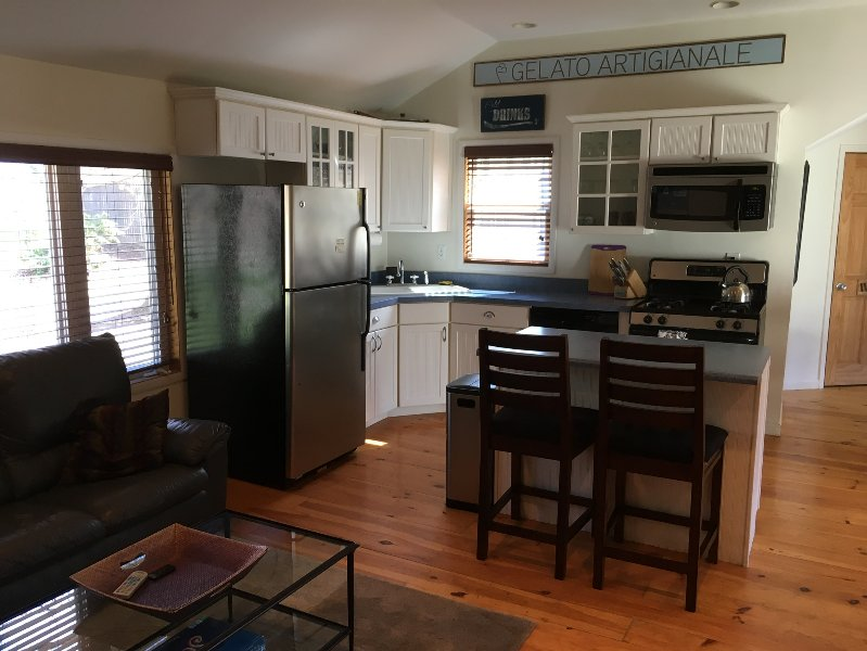 Full kitchen with all appliances and cookware.