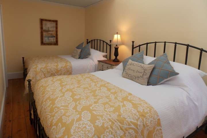Comfy Queen Beds for a good nights' rest after a day of walking the historic downtown area