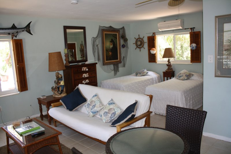 two single beds, futon sofa and small dining table for 2.