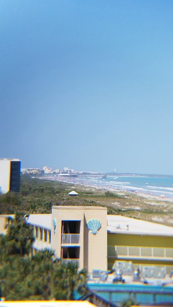 The Cocoa Beach Pier with Cape Canaveral launch pads in the background.