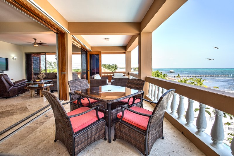 Spacious, oceanfront balcony with outdoor living AND dining furniture!