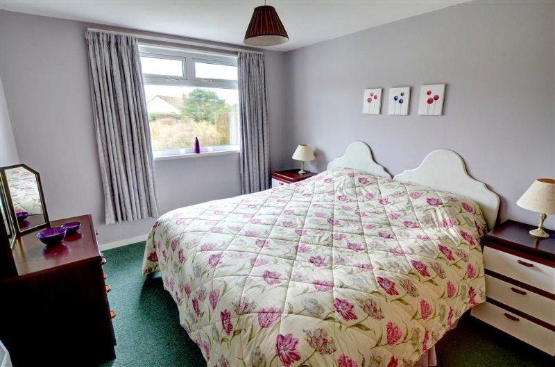 De master slaapkamer kan worden gemaakt als super kingsize bed of twee aparte bedden