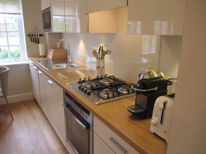 Well equipped kitchen including Nespresso coffee machine with capsules.