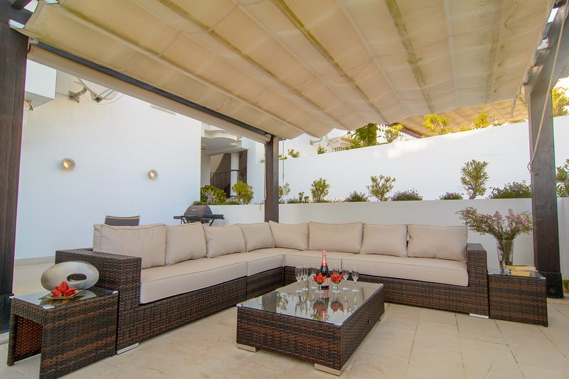 Large terrace (50m2) with BBQ and dining area