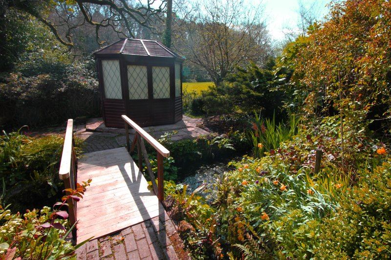 The chapel was built on the site of a holy well that feeds a stream running through the grounds.