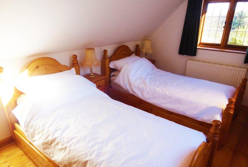 Camera da letto 3 ha due letti singoli.