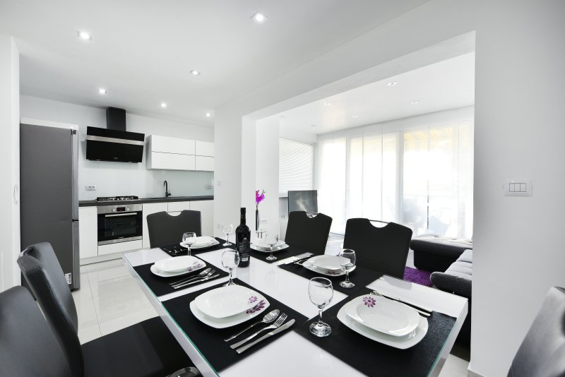 Modern kitchen and dining room.
