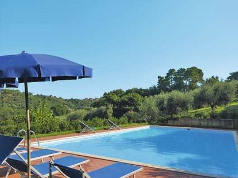 Large pool with sunloungers deck chairs and beautiful views