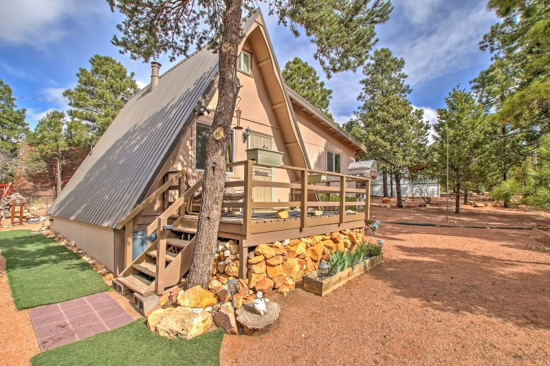 Experience the deserts of Heber in comfort when you stay at this charming 2-bedroom, 1-bathroom vacation rental cabin, nestled in the shade of tall pine trees.