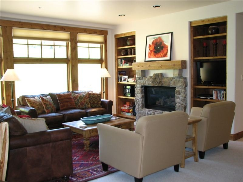 Enjoy our light filled living area.  Steps away from the lifts!