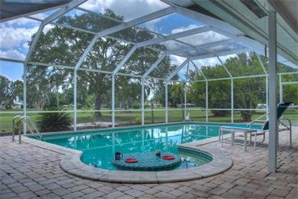 Premium home on golf course with heated swimming pool. A rare find