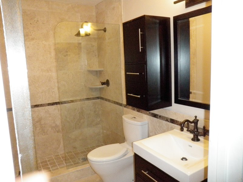 newly renovated guest bathroom with beautiful travertine tiles
