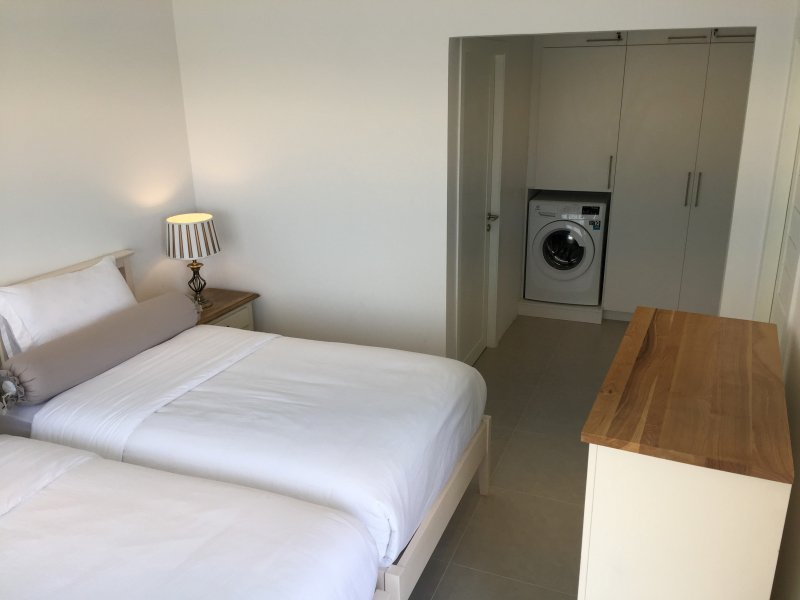 Bedroom 3 with twin beds. Bedroom 3 contains a washing machine.