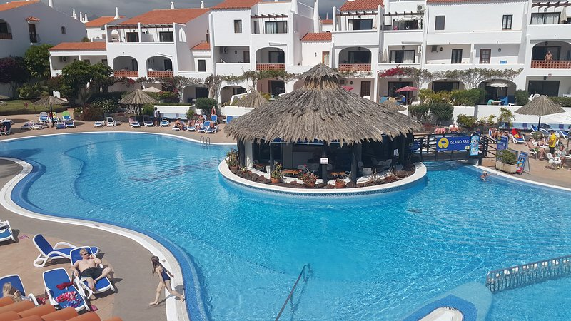 Heated pool and pool bar cleaned daily