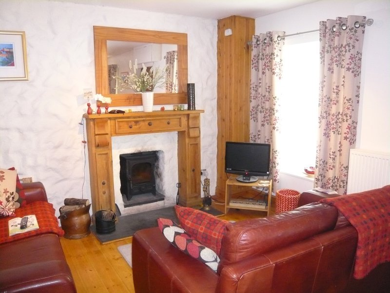 Comfortable relaxing living room and for those cool evening the wood burning stove