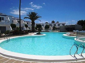 Appartement avec vue sur la grande piscine invitant