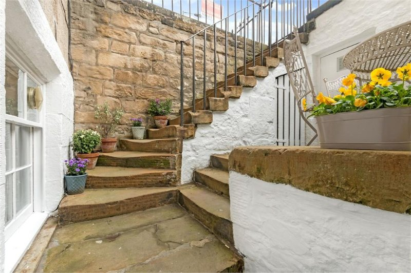 Steps down to front door