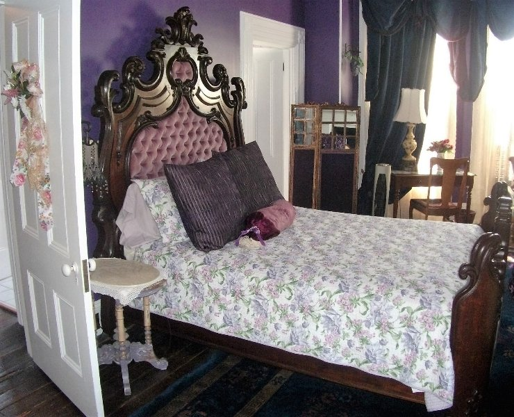 queen size Civil War era French style ornate bed in Master Suite