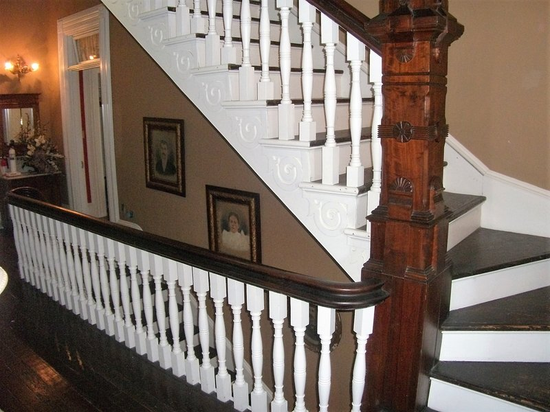 grand staircase (not steep or narrow) ascends to top floor Tower Suite.