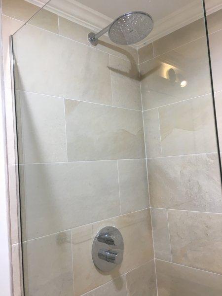 Walk in tiled shower, landing bathroom