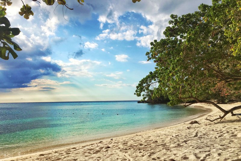 Secluded white sand beach private to Little Bay Country Club