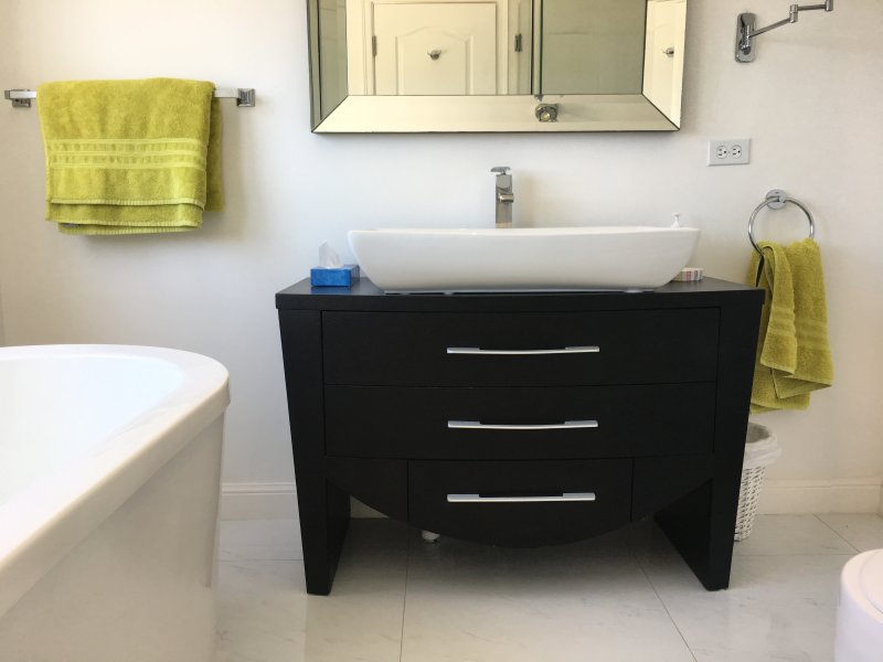 Master en-suite bathroom with tub and separate shower