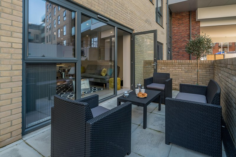 Lovely seating area on a terrace in a private garden patio, perfect for sunny days.